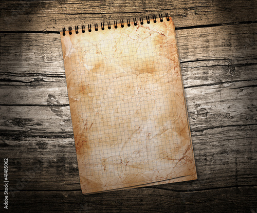 old used notebook on wood background