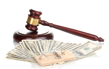 Dollar banknotes with judge's gavel and mousetrap isolated