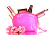 Make up bag with cosmetics and brushes on pink background