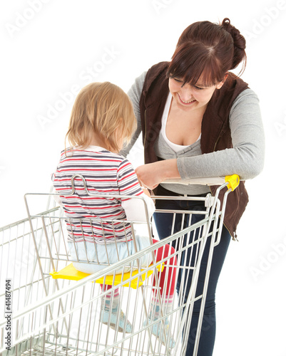 shopping mother with baby in trolley