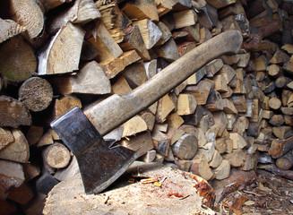 Old axe and firewood
