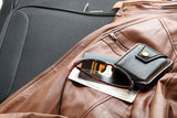Leather jacket with travel necessities ready to travel poster