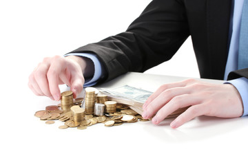 Businessman put coins isolated on white