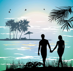 couple holding hands on the beach going on the ocean