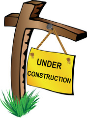 Wooden pole with under construction sign