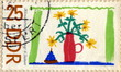 "Canceled german stamp ""Child's drawing - flowers"""