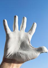 Hand against sky
