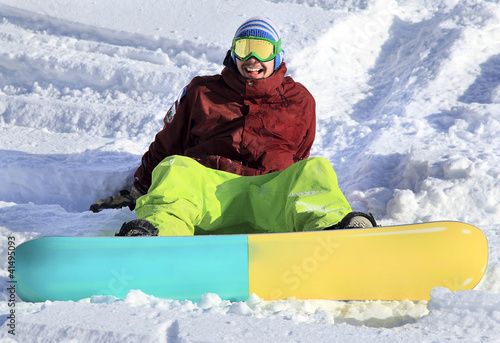 Happy young snowboarder
