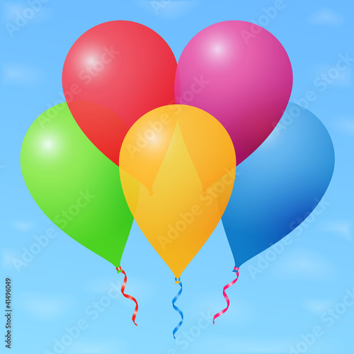 Colored balloons in sky