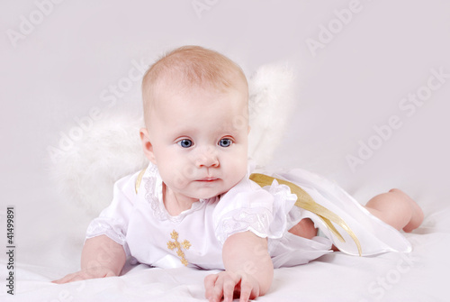 Lying baby with angel wings