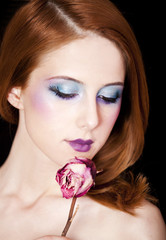 Portrait of beautiful redhead girl with style make-up.