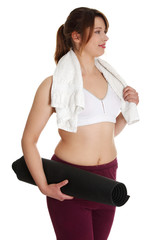 Overweight woman with towel and yoga mat