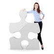 young business woman and a 3d puzzle piece