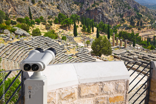 Binoculars and ancient city Delphi, Greece