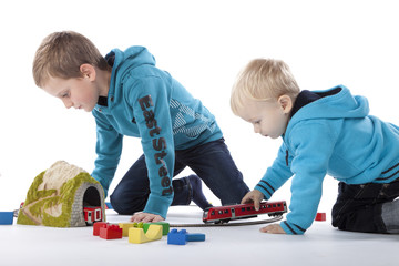 boys are playing with a train