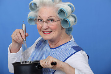 Granny cooking with her hair in rollers