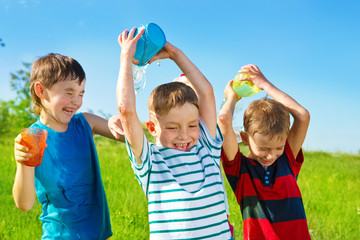 Preschool boys pouring water