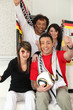 Two couples supporting German football