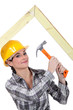 Woman building truss