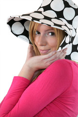 Shy girl with dotted hat