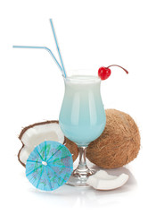 Blue hawaii cocktail and coconuts