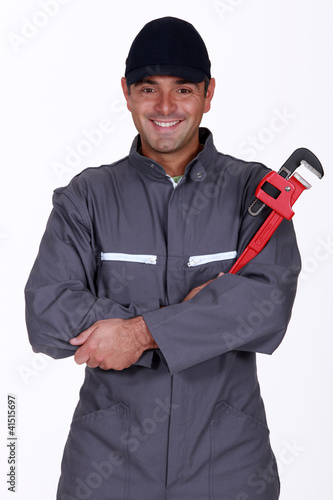 mechanic holding a spanner