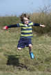 Boy jumping a ditch
