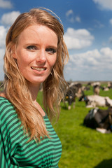Dutch girl in field with cows