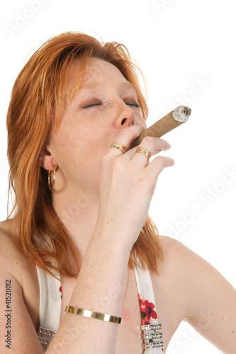 Young woman is smoking a cigar