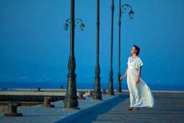 Beautiful woman on a pier