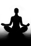 Silhouette of woman sitting in lotus position poster