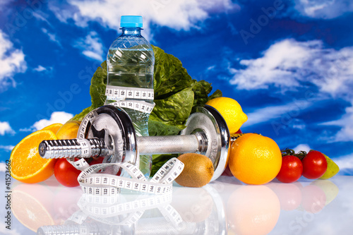 fitness dumbbells, water and fruits