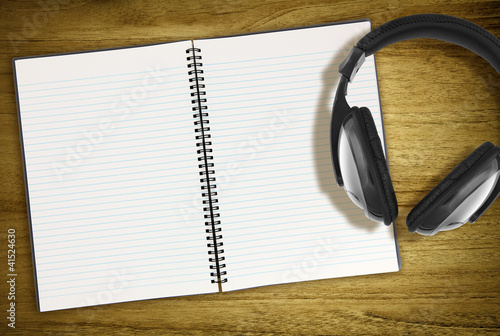 open notebook and headphones