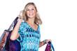 Hübsche Frau beim Shopping lacht mit Einkaufstaschen