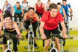 Fototapety Spinning class sport people exercise at gym