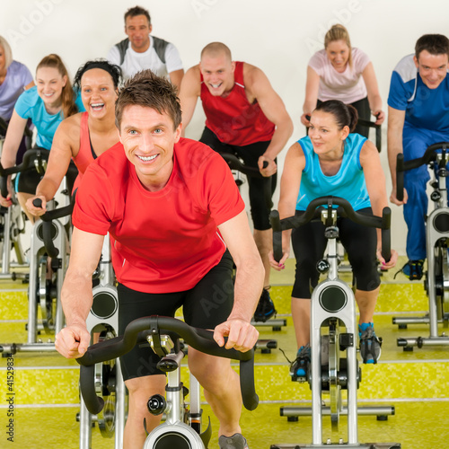 Fitness instructor with spinning class