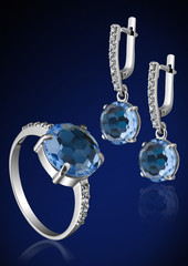 Jewelry set with brilliants on blue
