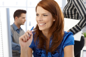 Laughing office worker woman