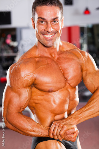 professional male bodybuilder posing in gym