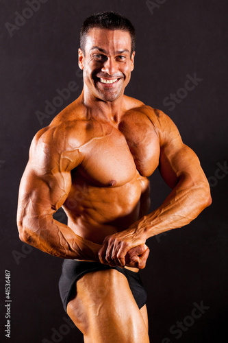 male bodybuilder on black background