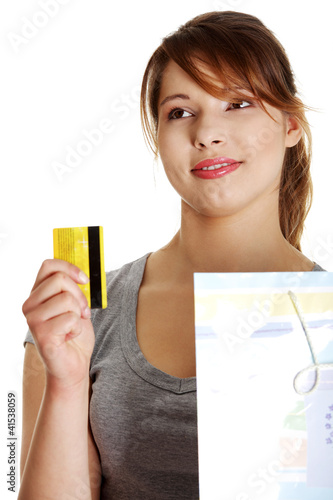 Woman with shopping bag holding credit card