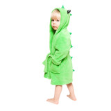 The little boy in green dressing gown