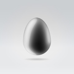 Pure black glossy plastic egg hanging in space