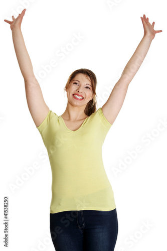 Young happy woman with hands up