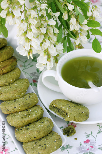 Green tea and biscuits with powder matcha