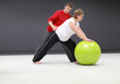 pregnant woman exercising with personal trainer