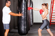 fitness woman training with punch bag in gym