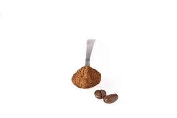 cucchiaino di caffè e chicchi