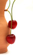 cherries on clay jug