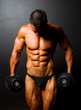 bodybuilder with dumbbells on black background